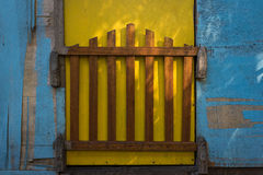 No entry. A shot of colourful house with a wooden gate Stock Photos