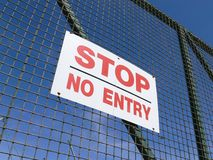 No Entry Sign. A Stop No Entry sign on a metal gate Stock Images