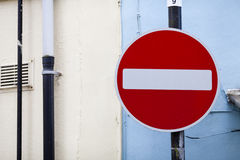 No Entry sign against a blue wall. Taken in Carmarthen, Carmarthenshire, South West Wales Stock Image
