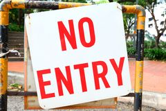 No entry. Sign on black and yellow metal barrier Stock Photo