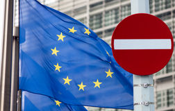 No entry sign in front of EU flag. Sanctions concept. Royalty Free Stock Photography