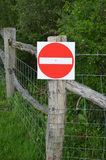 No entry sign on gate. Stock Photos