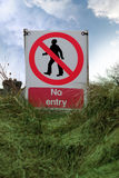 No entry sign on grass with clouds Stock Images