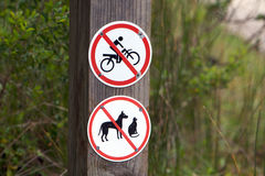 No entry sign - no bicycle and animals. No entry road sign with no bicycle and animals on a wooden pole Stock Images