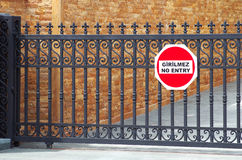No entry sign. On a security barrier, written in english and turkish Stock Photos