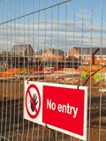 No entry sign on security fence UK. No entry warning sign on fence on a building site in Cheshire England United Kingdom Europe royalty free stock photos