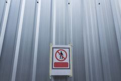 No entry sign on site background. Background of no entry sign on corrugated galvanized construction site wall Stock Image