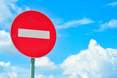 NO ENTRY Traffic sign against blue sky with clouds Royalty Free Stock Photo