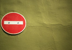 No entry on wall. No entry sign attached to yellow brown painted wall Royalty Free Stock Photo