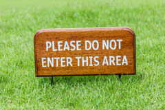 No entry wooden sign placed on green grass and blurred natural f Stock Photography