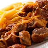 No espeto, batatas fritas e vegetais Imagem de Stock Royalty Free