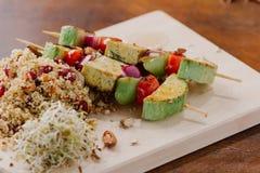 No espeto do Tofu no painço com amêndoas, chamadas do painço e arandos Imagens de Stock Royalty Free