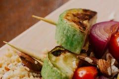 No espeto do Tofu no painço com amêndoas, chamadas do painço e arandos Imagem de Stock