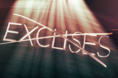 No excuses concept. Conceptual words on blackboard Stock Image