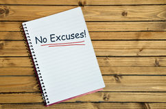 No Excuses word on notebook Stock Images