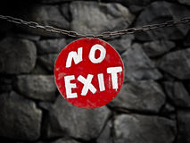No Exit Sign. A retro-looking red NO EXIT sign chained to a stone wall royalty free stock photos