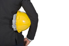 No face Unrecognizable person. torso of engineer or worker hold. In hand yellow helmet for workers security isolated on white background. Man wear business suit Stock Photo