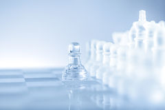 No fear. Single pawn staying against a full set of chess pieces Stock Image