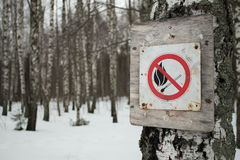 No-fire sign. Among the winter forest Stock Photo