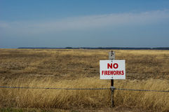NO Fireworks. A NO Fireworks sign in the middle of an open field Stock Photos