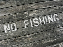No Fishing. Painted on pier Royalty Free Stock Image