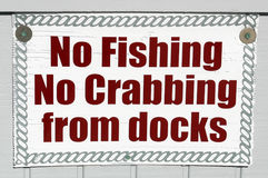 No Fishing. A sign on a dock that reads No Fishing No Crabbing from docks Royalty Free Stock Images