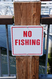 No Fishing. Sign on the side of the pier Stock Image