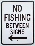 No Fishing Between Lines Sign. Metal No Fishing Between Lines metal street sign. No Fishing with left arrow metal sign stock image