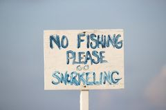 No fishing please go snorkeling sign. In Grand Cayman Islands stock photography