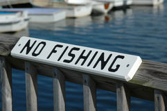 No fishing sign. On the railing of a dock stock photography
