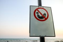 No fishing sign at the beach and copy space. Fishing label is prohibited by the sea. No fishing sign at the beach and copy space royalty free stock photos