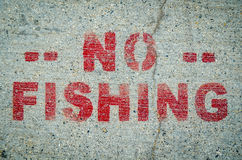 No Fishing Sign On Cement Stock Photos