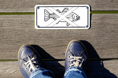 No Fishing sign. On a pier stock photo