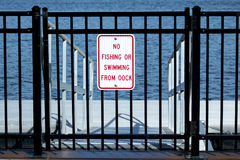 No fishing or swimming sign on a dock. In Athens NY Stock Images