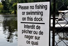 No fishing or swimming sign. Please no fishing or swimming on this dock sign Royalty Free Stock Images