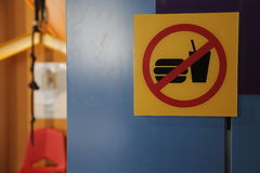 No food or drinks allowed!. No food or drinks sign on a blue wall Royalty Free Stock Photos