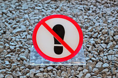 No footprints plastic sign on stone surface, modern security, Royalty Free Stock Photos