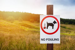 No fouling sign placed on meadow. Royalty Free Stock Images