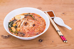 No frills Asian prawn mee vermicelli noodles with spicy soup. A serving of no frills Asian prawn mee vermicelli noodles with spicy soup stock image