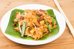 No frills simple Chinese Char Kway Teow or Fried Noodle on banana leaf Stock Images