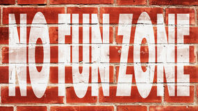 No Fun Zone On A Brick Wall Royalty Free Stock Photography
