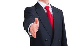 Homem de negócios novo que oferece agitar as mãos Fotografia de Stock