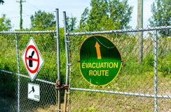 No garbage allowed and evacuation road sign on the fence in Montreal, Canada. The translation is `Evacuation road stock image
