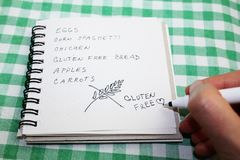 No gluten diet shopping list with a hand writing gluten free stock image