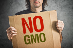 No GMO. Man holding banner with Anti GMO message stock photos