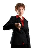 No go. Woman in black jacket with her thumb pointing down Stock Images