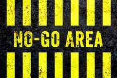"""No-Go Area"" warning sign in yellow letters painted on grungy concrete wall with yellow stripes. stock illustration"