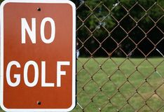 No Golf. No More Golf Sign with Chain Link Fence stock image