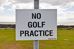 No golf practice sign with clouds, grass and sky Royalty Free Stock Photography