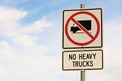 No Heavy Trucks Sign against Cloudy Blue Sky Background Stock Photos